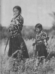 Beautiful Native American Lakota girls collecting firewood on Crying Hill in Mandan, North Dakota.  Resident Patrick Atkinson purchased 5 historically valuable acres on the southeast corner of Crying Hill to stop imminent urban development on the land.
